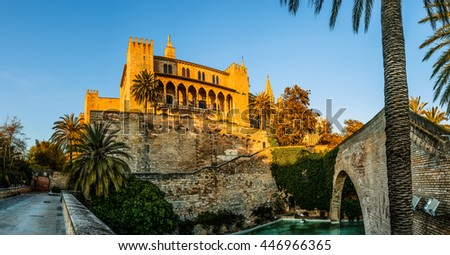Swans in a pond near Royal Palace of La Almudaina is Alcazar (fortified palace) of Palma, capital city of Island of Majorca, Spain. Having been built as an Arabian Fort. - stock photo