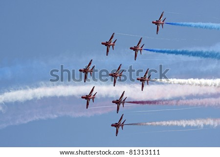 SWANSEA, UK - JULY 9: Red Arrows display at Swansea air show, South Wales, UK, July 9, 2011.