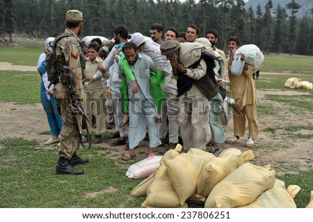 SWAT, PAKISTAN - SEPT  16: After the flood people were evacuated by the Pakistan army on September 16, 2010 in Swat Valley, Pakistan.
