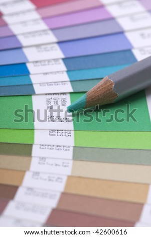 Swatch book and colored pencil - stock photo