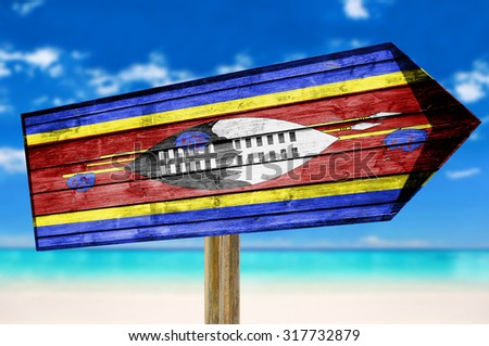 Swaziland Flag wooden sign on beach background