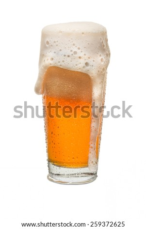 Sweated Craft Pub Beer Glass Overflowing with Beer #2 - stock photo