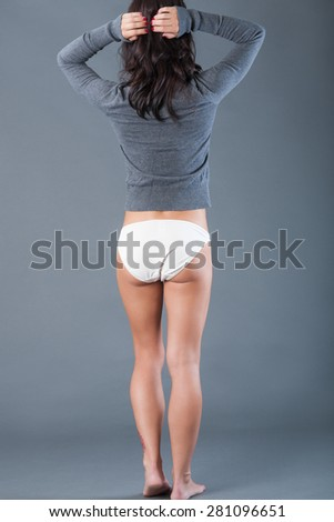 Sweater and bikini bottoms - stock photo