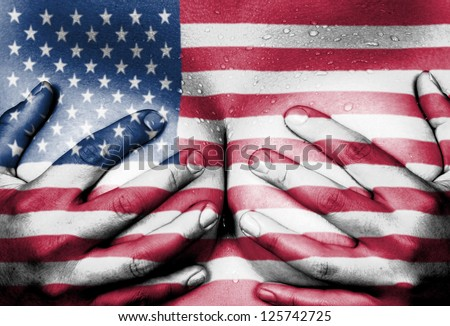 Sweaty upper part of female body, hands covering breasts, flag of the USA - stock photo