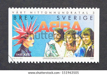 SWEDEN - CIRCA 2000: a postage stamp printed in Sweden commemorative of Sweden music with the image of swedish bands Abba and Inrikes, circa 2000.  - stock photo