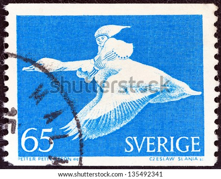 SWEDEN - CIRCA 1971: A stamp printed in Sweden shows Nils Holgersson on goose (from the wonderful adventures of Nils by Selma Lagerlof), circa 1971. - stock photo