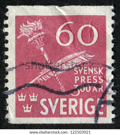 SWEDEN - CIRCA 1945: A stamp printed in Sweden, shows Torch and Quill Pen, Scott Catalog 361 A82, circa 1945
