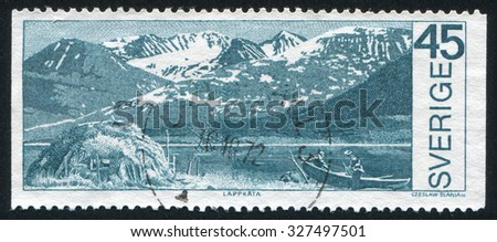 SWEDEN - CIRCA 1970: stamp printed by Sweden, shows Boat on mountain lake in Stora Sjofellet National Park, circa 1970