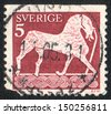SWEDEN - CIRCA 1973: stamp printed by SWEDEN, shows Picture of a horse on a stone, Gotland, circa 1981   - stock photo