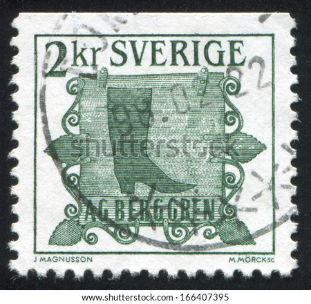 SWEDEN - CIRCA 1985: stamp printed by Sweden, shows Trade sign of shoemaker in Norrkoping, circa 1985