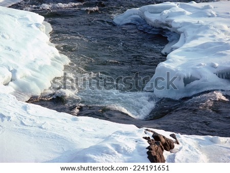 Sweden, snow-covered river - stock photo