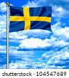 Sweden waving flag against blue sky - stock photo