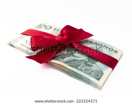 Swedish bills tied with red satin ribbon. - stock photo