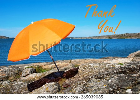 Swedish Coastline Bohuslan Archipelago Swedish West Coast With Rocks And Cliffs And Beach With Orange Parasol And English Text Thank You With Ocean And Open Sea Sunny Weather With Blue Sky - stock photo