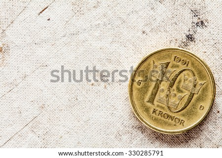 Swedish Coin - Ten Kronor on the canvas background with copy-space - stock photo