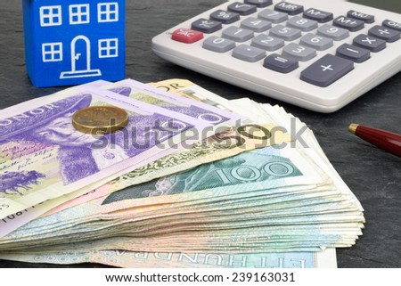 Swedish currency, calculator, toy house and pen to represent property finance. - stock photo