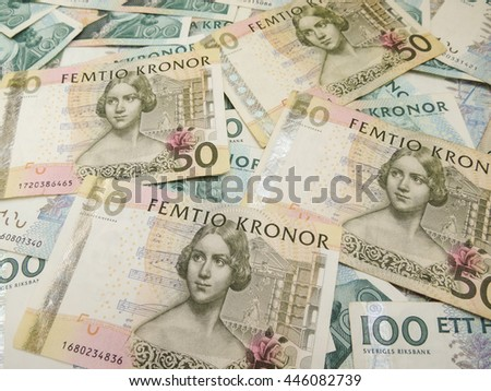 Swedish currency SEK from Sweden over blue background - stock photo