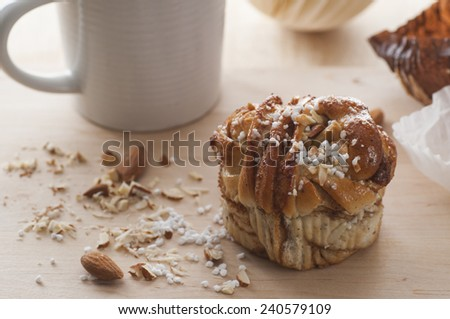 Swedish fika with homemade cinnamon bun. - stock photo