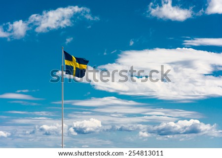 Swedish flag on sky background - stock photo