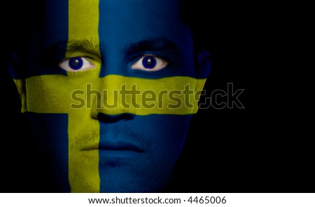 Swedish flag painted/projected onto a man's face.