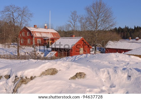 Swedish homestead in a winters surrounding - stock photo