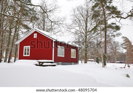 Swedish house in winter - stock photo