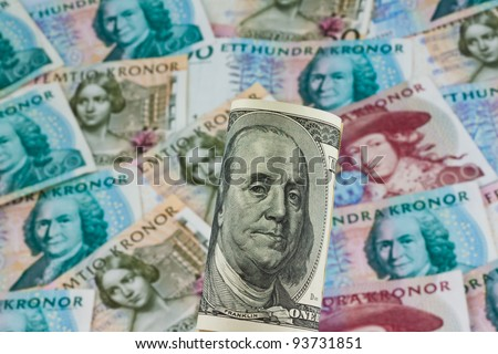 swedish krona, the currency of sweden. american dollar bills. - stock photo