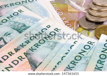 Swedish 100 Kroner banknotes and coins. - stock photo
