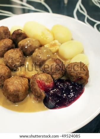 Swedish Meatballs (Kottbullar) with potatoes, gravy and lingonberries sauce - stock photo