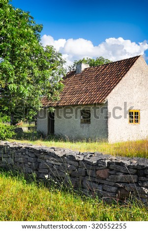 Swedish old country farm house in summer. Location: Gotland Island in the Baltic Sea.