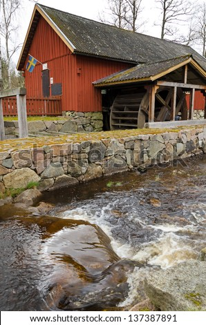 Swedish old watermill - stock photo