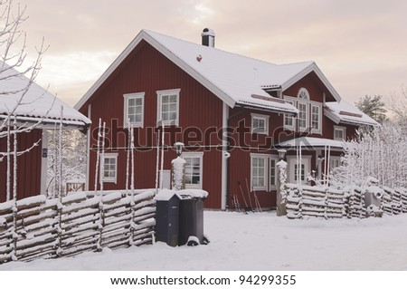 Swedish rural red house in a winter mornings setting