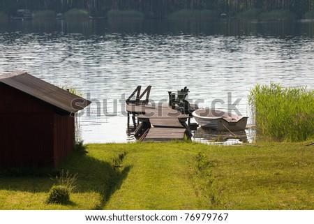 Swedish summer by an lake. - stock photo