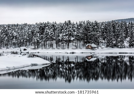 Swedish winter landscape with a little cabin in Lapland - stock photo