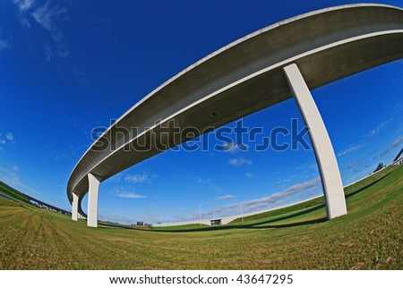 Sweeping expressway on crystal blue sky.