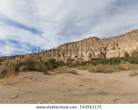 Sweeping landscape horizontal view on partly cloudy day of Tent Rocks National Monument on Cochiti Pueblo in Sandoval County New Mexico, USA