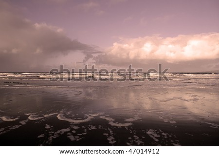 sweeping spraying waves after a storm of the west coast of ireland - stock photo