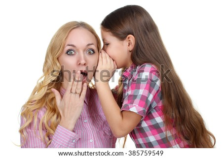 sweet and beautiful little girl tells mom something to the ear isolated on a white background - stock photo