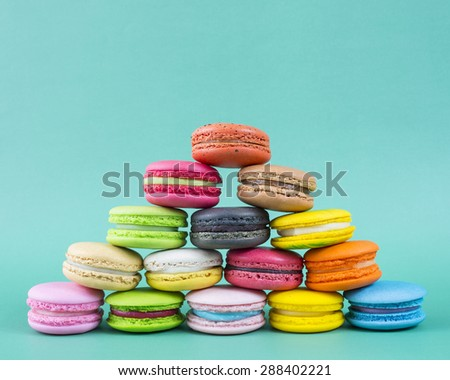 Sweet and colorful french macaroons on retro-vintage background  - stock photo