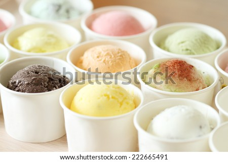 sweet and colorful ice cream scoops in white cups - stock photo