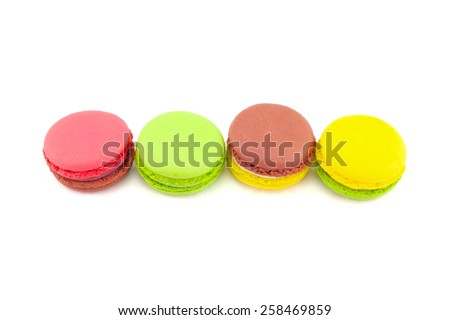 Sweet and colourful french macaroons isolated on white  background .