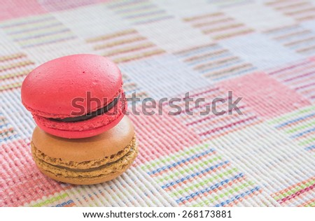 Sweet and colourful french macaroons on cotton cloth background . - stock photo