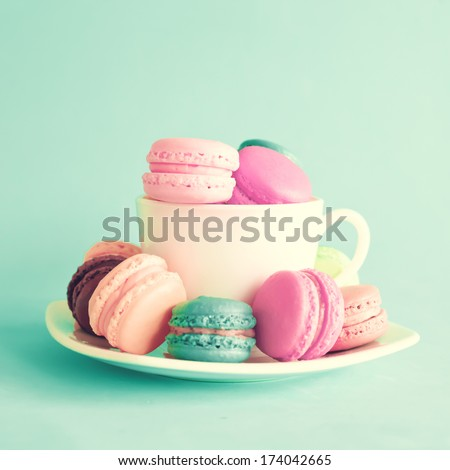 Sweet and colourful french macaroons on retro-vintage background  - stock photo