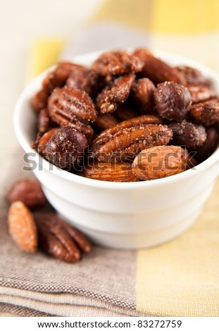Sweet and Salty Spiced Nuts Served in Small Bowl - stock photo