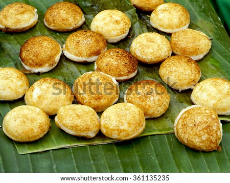Sweet and Savory Grilled Coconut-Rice Hotcakes, Coconut Rice Cake, Asian dessert, Thai, Thailand, Luang Prabang, Laos - stock photo