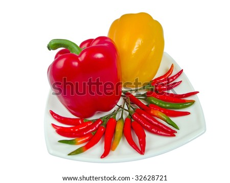 Sweet and sharp pepper on one plate - stock photo