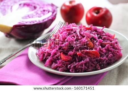 Sweet-and-sour cabbage stewed with apples - stock photo