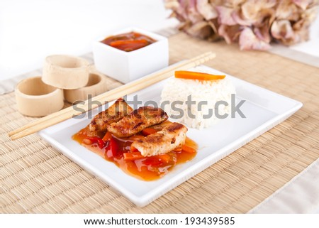 Sweet and sour meat on white rice  - stock photo