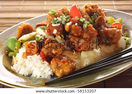 Sweet and sour pork and rice. Part of a series of nine Asian food dishes. - stock photo
