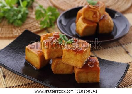 Sweet and sour  tofu on dish vegetarian food. - stock photo